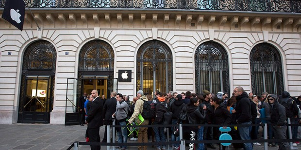 Paris, France: Customers queue outside the Apple store